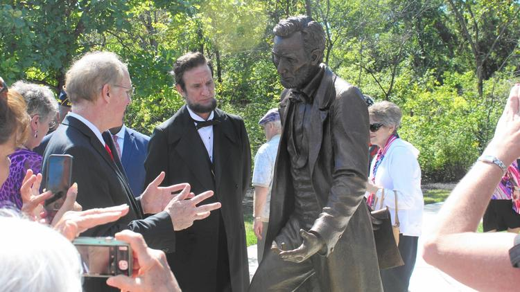 U.S. Rep. Bill                         Foster, D-Naperville, and Lincoln interpreter                         Michael Krebs, admire a statue of the 16th                         president. The statue, located at the Abraham                         Lincoln National Cemetery in Elwood, is the                         first statue of a U.S. president to be featured                         in a national cemetery. (Alicia Fabbre / Daily                         Southtown)